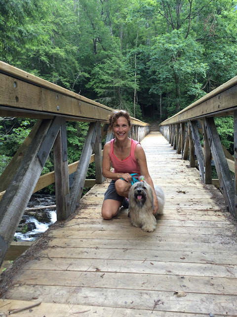 Diane Silver and Rocco Havanese on the bridge at Tumbling Waters trail
