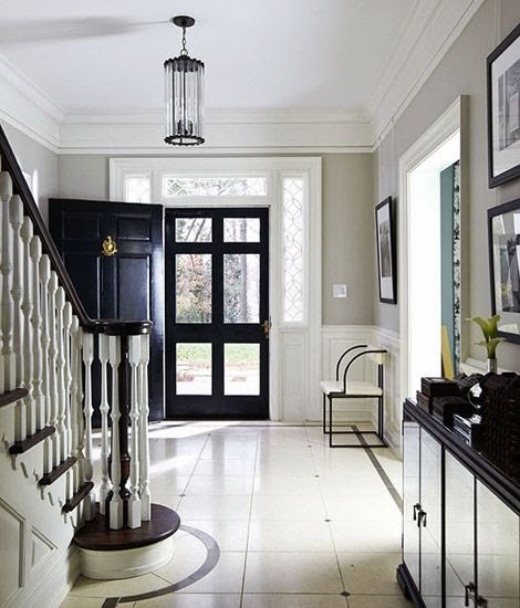 beautiful traditional  black and white marble entry foyer with black door