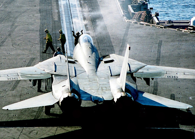 "Flight Deck Director guides an F-14D ""Tomcat""  onto catapult one for its next catapult launch."