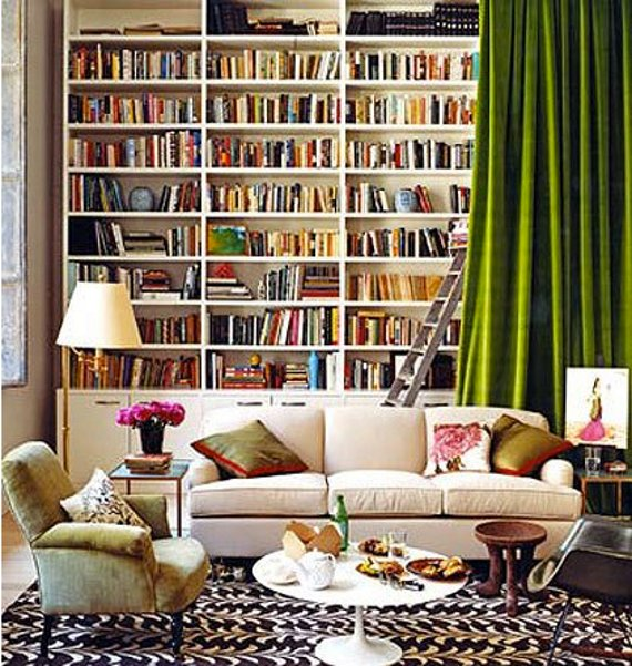 gorgeous bookcase with curtain - part of a roundup of wall covering ideas for renters! lots of good ideas