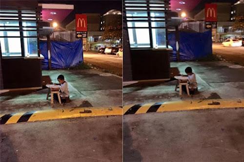 Menino morador de rua usa iluminação de restaurante para fazer lição de casa e comove internautas