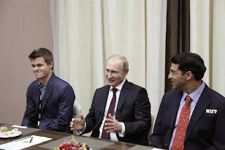 Poutine, Anand et Carlsen à Sotchi au championnat du monde d'échecs 2014 © Chess & Strategy