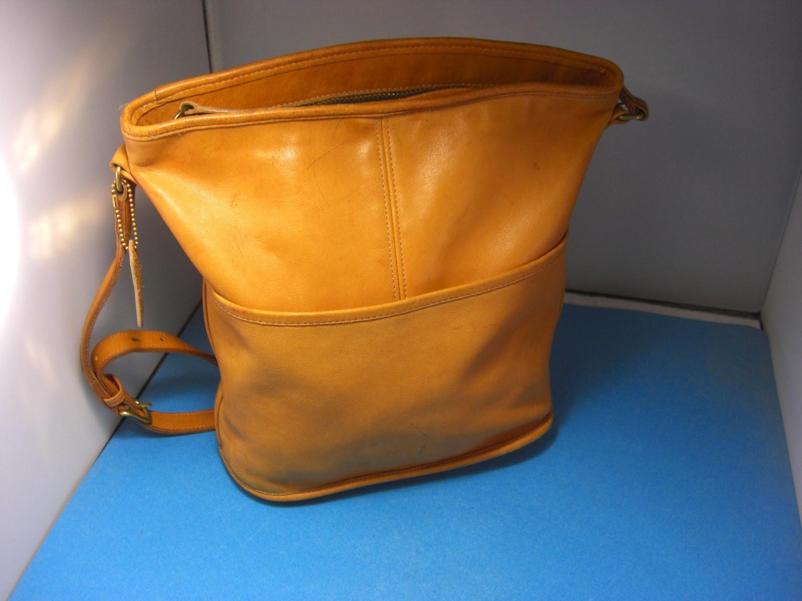 http://bargaincart.ecrater.com/p/22233074/authentic-coach-tan-leather-0245-013-crossbody