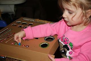 http://anniesadventuresinhomeschooling.blogspot.ca/2013/12/the-busy-box.html