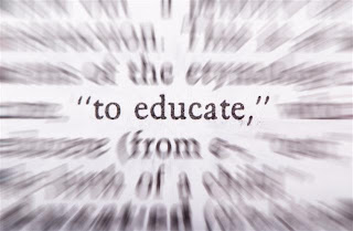 the word educate on blurred page