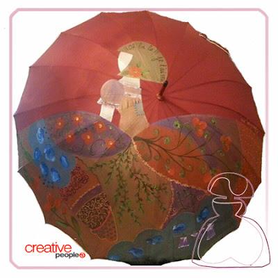 Paraguas modelo Menina de Sylvia López Morant realizado en tono rojo.