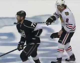 Duncan Keith whacks Jeff Carter in the face