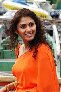 manjari hot boobs in orange dress