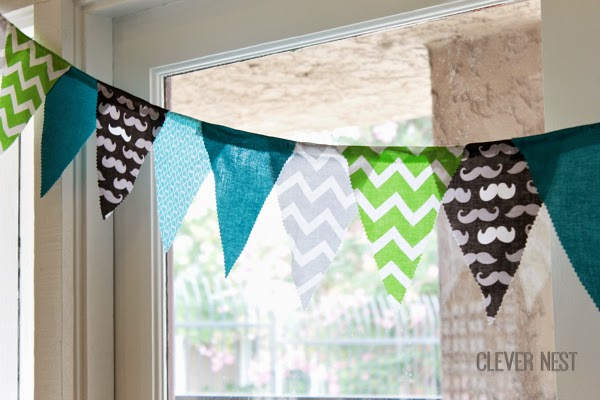 baby shower idea- make an extra long bunting to reach all the way around the room for a big effect! #aquagraylime #boysfirstbirthday #hipsterparty #littlemantheme #clevernest #babyshowergameideas