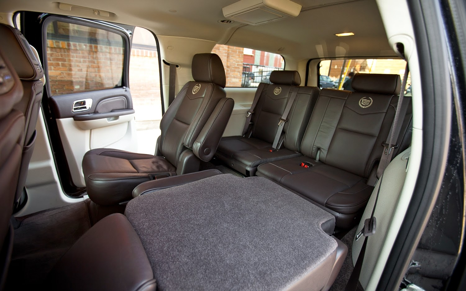To further convey the feel of luxury, the ESV comes with a variety of optional features. Options include: 22-inch chrome wheels, sunroof, multilevel cooling for the front seats, and a heated power-tilting steering wheel. The ESV does not come with the option of fold flat third row seats like the original, but the seats are removable. When removed, the ESV provides 90 cubic ft. of cargo space and with the fold and flip second row compacted, maximum capacity is 137 cubic ft. With all the seats in place, there is still 46 cubic ft. available in this extended length Escalade.