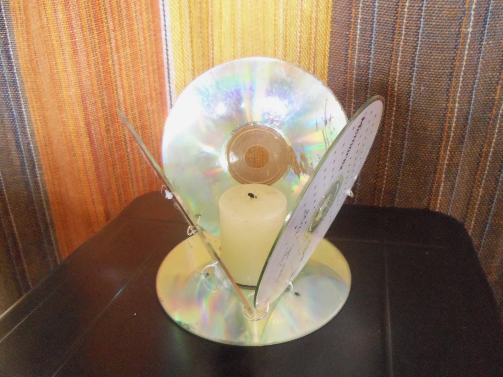 Reciclaje con Artesania: porta velas de CD reciclado.