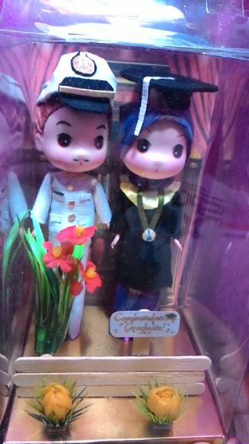Boneka TNI dan Wisuda