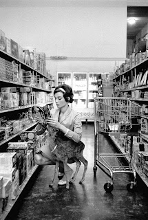 audrey hepburn in a supermarket with a deer