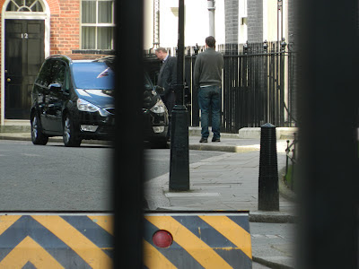 David Cameron outside Number 10, Downing Street, talking into a mobile phone - Sunday 13th April 2012