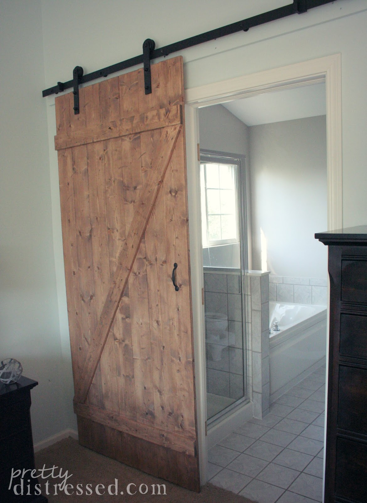 Pretty distressed diy distressed sliding barn door for Sliding entry doors