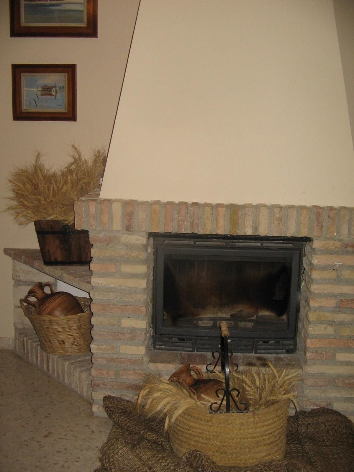 La habitacion de la chacha 00330 chimenea revestida con for Chimeneas ladrillo visto