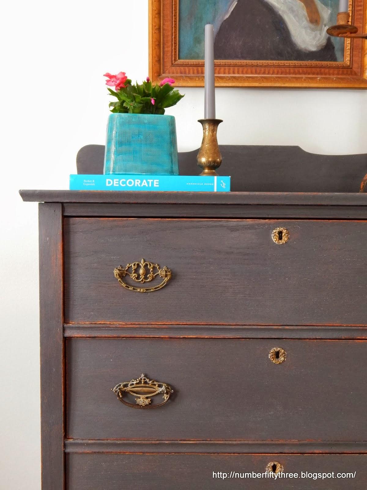 http://numberfiftythree.blogspot.com/2014/01/charcoal-gray-and-brass-antique-dresser.html