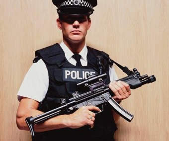 17 Police Officer Holding Machine Gun