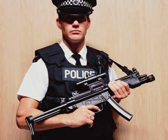 Police Officer Holding Machine Gun