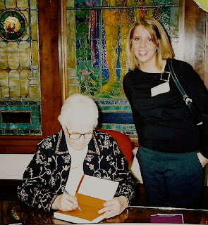 Jessica with Harper Lee signing a book