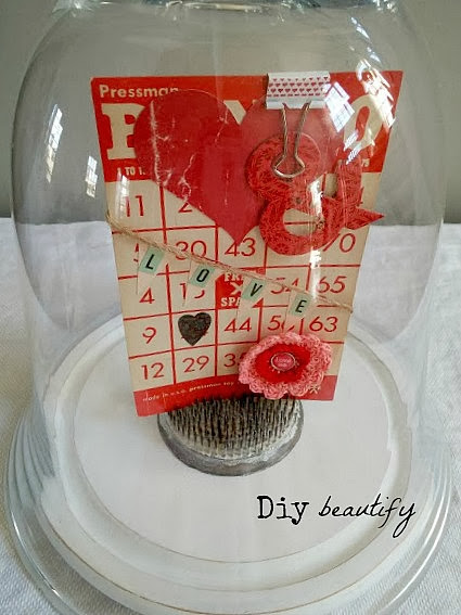 Display vintage Bingo card and other ephemera in a glass cloche for a sweet display! Find more at diy beautify!