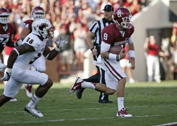 Quarterback Trevor Knight #9 of the Oklahoma Sooners outruns safety Mitch Lane #38 of the Louisiana Monroe Warhawks in the first half August 31, 2013 at Gaylord Family-Oklahoma Memorial Stadium in Norman, Oklahoma. (August 30, 2013 - Source: Brett Deering/Getty Images North America)