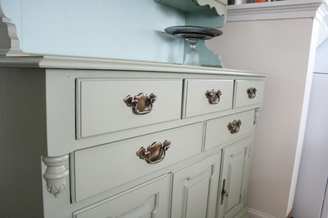 Original drawer pulls on painted hutch. See more photos here: http://everclevermom.com/2012/03/a-50-hutch-makeover-and-other-life-changing-moments/
