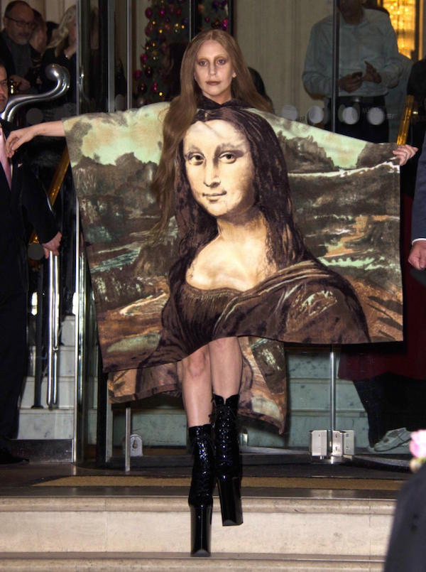 Lady Gaga walking in a Mona Lisa Portrait outfit