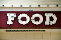 "picture of a sign that simply states ""food"""