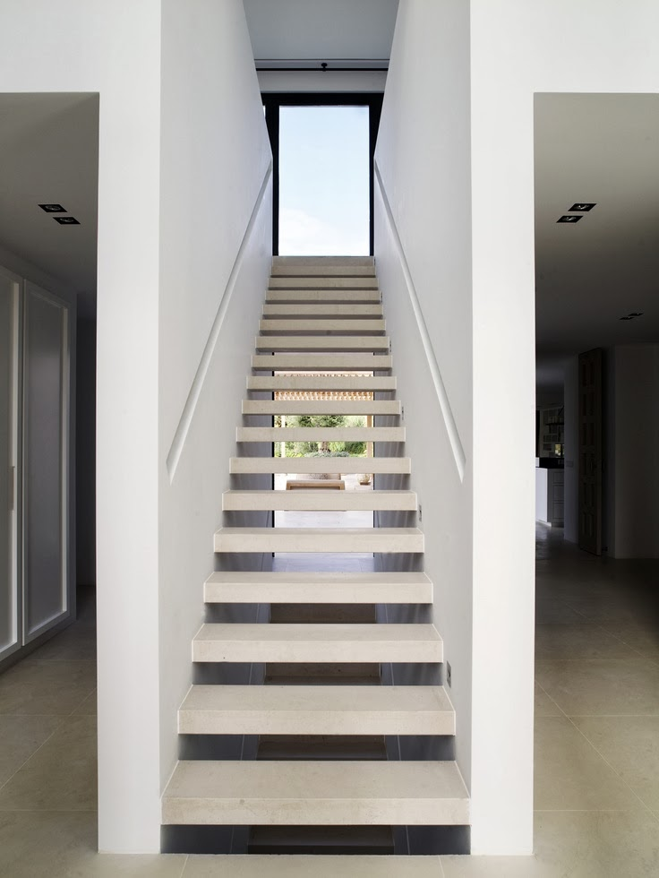 floating stairs with recessed handrail
