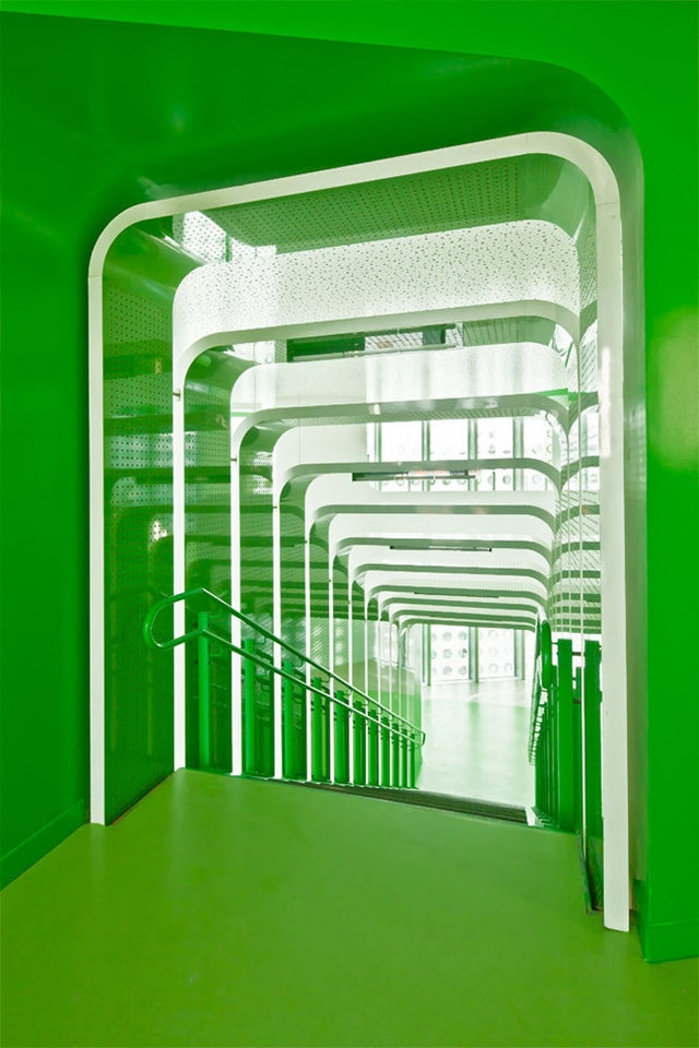 Photo of green painted staircase looking down