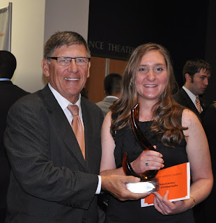 Megan Konarik, who received the Excellence in Service Award for the College of Criminal Justice, is pictured with Dr. Vincent Webb, Dean of the College.