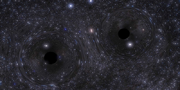 A pair of closely orbiting black holes. Credit: Northwestern University
