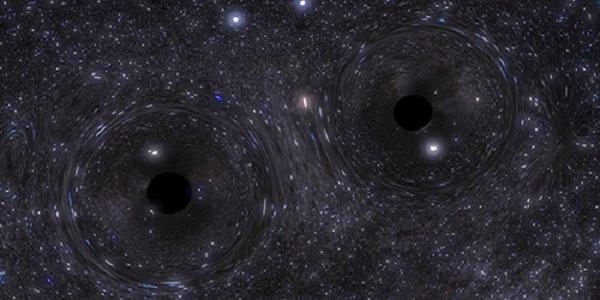 A pair of closely orbiting black holes. Credit: Northwestern University