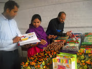 Shamim Masih and School teachers prepare gifts for the children of Mardan. (picture )