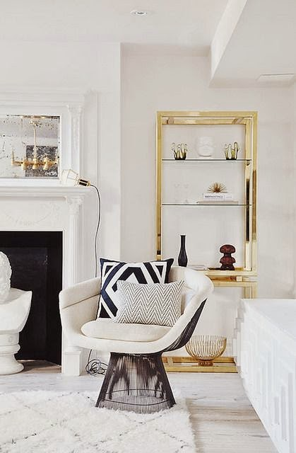 white living room gold etagere bookcase fireplace