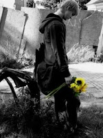 boy alone with flowers in hand