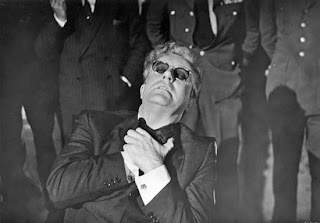 Dr. Strangelove struggles to control his hand