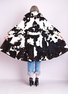 Vintage 1960's black and white cow print leather coat with large collar.
