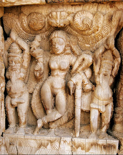 Mohini, the enchantress, feminine from of Vishnu, touching her head while dancing with the demon Bhasmaka; Marble statue from Rajasthan.