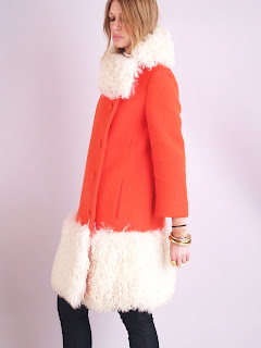 Vintage 1960's orange-red sherbet colored Lilli Ann wool coat with white mongolian fur trim.