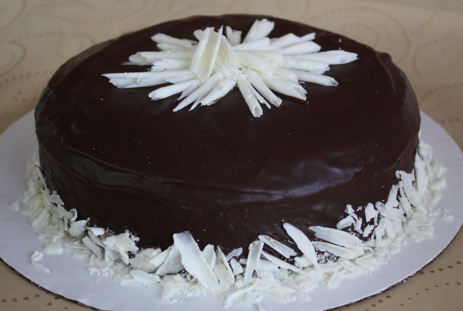Dark fudge chocolate cake with chocolate ganache icing and white ...