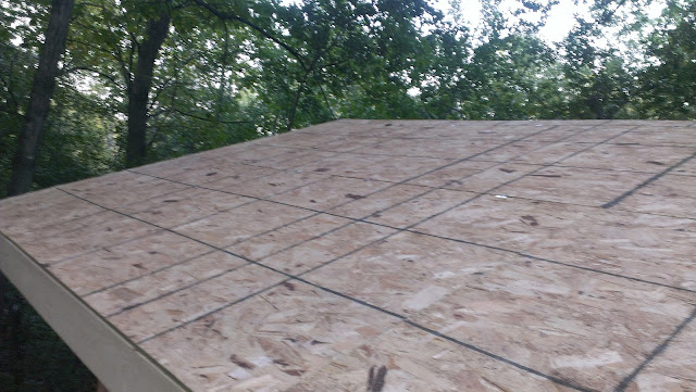 Finished view of one side of the roof sheathing.