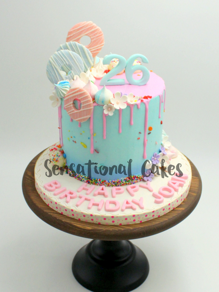 The Sensational Cakes Pastel Drip Cake with Candies Fondant Theme