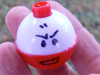 hand drawn electrode face on a red and white bobber