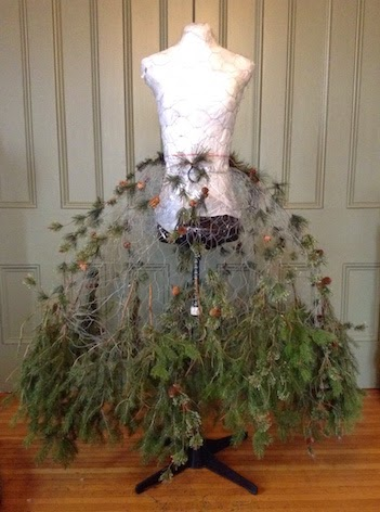after protecting my mannequin i used chicken wire to create a stiff skirt to support the heavy and full skirt of greenery