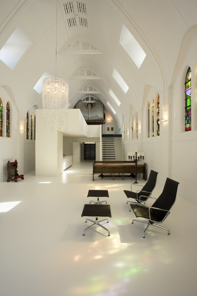 Dark furniture in white minimal church home