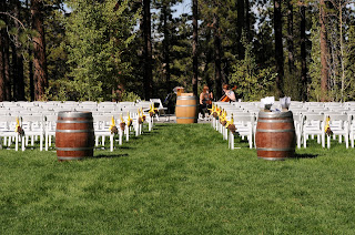 rustic outdoor wedding ceremony decor by Take the Cake Events