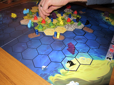 Survive: Escape From Atlantis - The board with explorers on boats and and whales, sharks and sea serpents in the surrounding waters