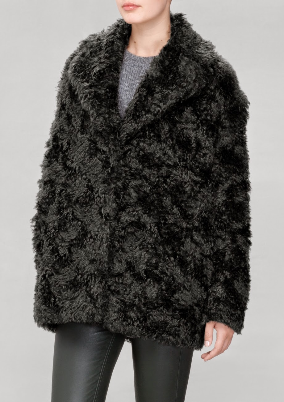stories black fur coat